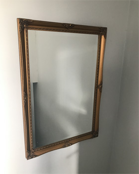 The gold mirror before