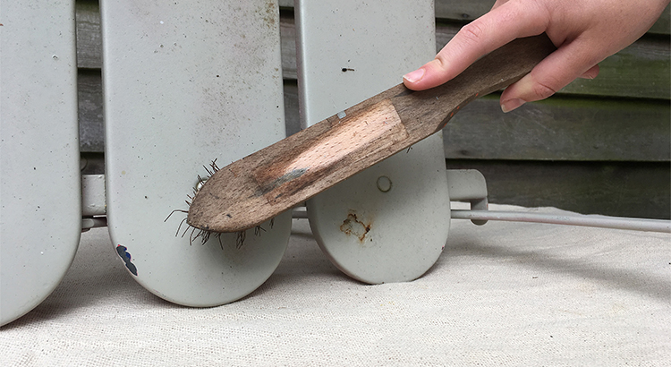 2 - use wire brush to remove flakes of rust and old paint